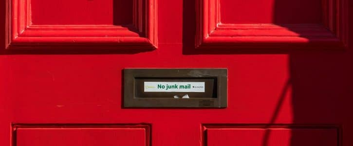 "a red door with the sign ""no spam"""