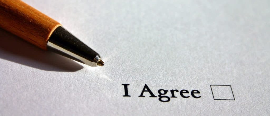 """picture of a pen next to a checkbox stating """"I agree"""""""