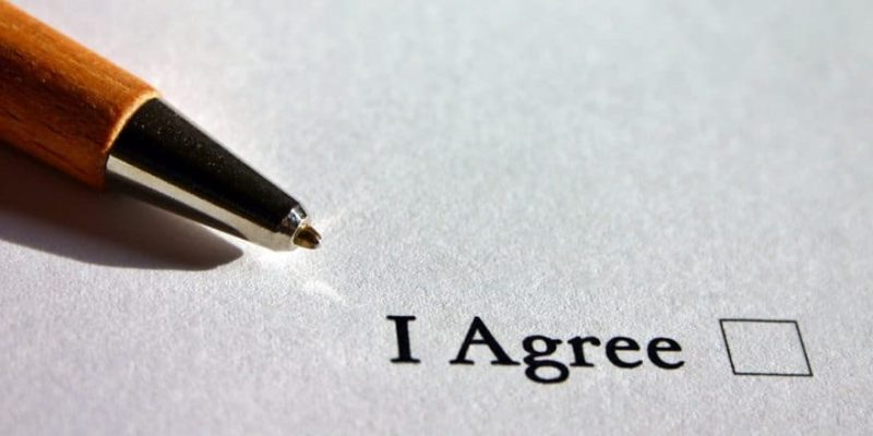 "picture of a pen next to a checkbox stating ""I agree"""